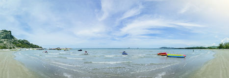Panorama view of the blue sea and clean beach with beautiful blue sky and cloud, jetski ,banana boat on a surface of sea, filtered Stock Images