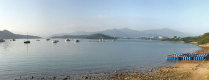 Panorama view boat, mountain and ocean in daytime Royalty Free Stock Image