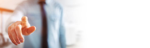 Panorama view of businessman pointing finger. On blurred background Royalty Free Stock Photos