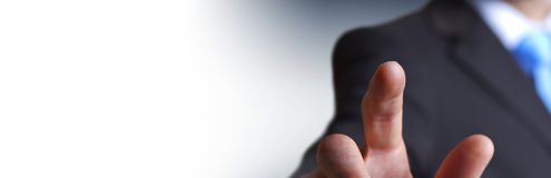 Panorama view of businessman pointing finger. On blurred background Royalty Free Stock Photo
