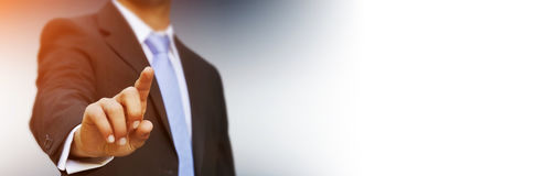 Panorama view of businessman pointing finger. On blurred background Stock Photography