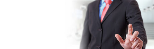 Panorama view of businessman pointing finger. On blurred background Stock Images