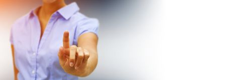 Panorama view of businesswoman pointing finger. On blurred background Royalty Free Stock Image