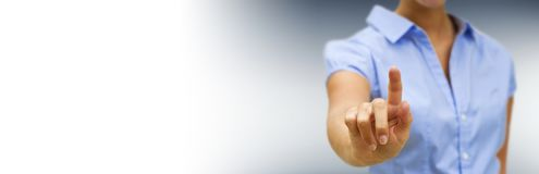 Panorama view of businesswoman pointing finger. On blurred background Stock Images