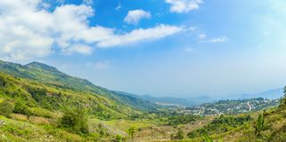 Panorama view of cabbage and strawberry farming in the mountains Stock Photos