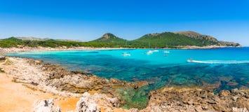 Panorama view of Cala Agulla beach bay Majorca Spain. Spain Mediterranean Sea, Mallorca island, beautiful panorama view of bay beach Cala Agulla, Majorca Royalty Free Stock Photos