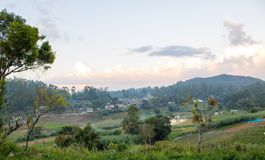 Panorama view of city and cultivation lands royalty free stock photography