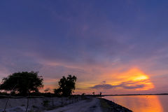 Panorama view with colourful sunset and twilight sky,, tropical island Bali, Indonesia. Dark scene with car and Stock Photography