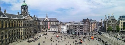 Panorama view of Dam Square in Amsterdam. A Panorama view of Dam Square in Amsterdam, Netherlands. Dam Square is Amsterdam's beating heart stock photography