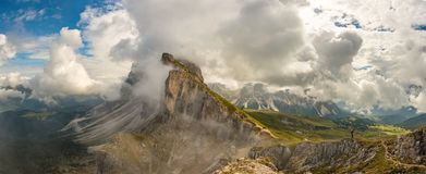 Panorama view Dolomites mountains from Seceda over Odle Puez royalty free stock photo