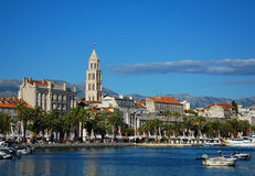 Panorama view on the downtown and bay of Split. White yachts moored at the berthed, on the roofs of houses orange tile. Beautiful view of Split Royalty Free Stock Photo