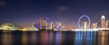 Panorama view of downtown business buildings area at night in Singapore. Singapore is a world famous tourist city stock image