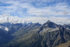 Panorama view of dramatic sky and mountains scene in national park Dombay. Panorama view of dramatic blue sky and mountains scene in national park Dombay royalty free stock image