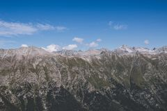 Panorama view of dramatic sky and mountains scene in national park Dombay. Panorama view of dramatic blue sky and mountains scene in national park Dombay royalty free stock photography