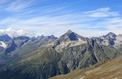 Panorama view of dramatic sky and mountains scene in national park Dombay. Panorama view of dramatic blue sky and mountains scene in national park Dombay stock image