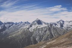 Panorama view of dramatic sky and mountains scene in national park Dombay. Panorama view of dramatic blue sky and mountains scene in national park Dombay stock images