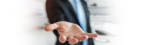 Panorama view of empty businessman hand. On blurred background Stock Photo