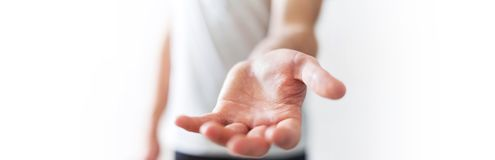 Panorama view of empty businessman hand. On blurred background Stock Images
