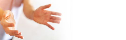 Panorama view of empty businessman hand. On blurred background Royalty Free Stock Images