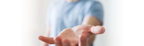 Panorama view of empty businessman hand. On blurred background Stock Image