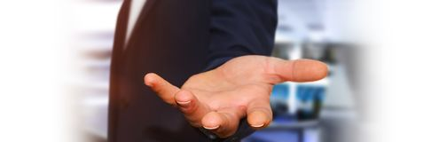 Panorama view of empty businessman hand. On blurred background Royalty Free Stock Image