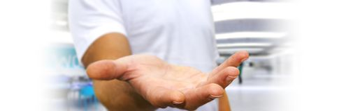 Panorama view of empty businessman hand. On blurred background Stock Photos