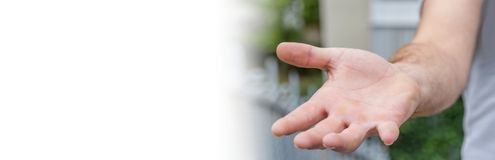 Panorama view of empty businessman hand. On blurred background Royalty Free Stock Photography