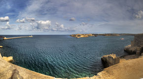 Panorama view of the entrance to the Valletta city harbor at Malta guarded by two lighthouses Royalty Free Stock Images