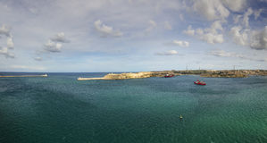 Panorama view of the entrance to the Valletta city harbor at Malta guarded by two lighthouses Royalty Free Stock Photo