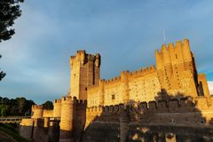 Castle of La Mota in Medina del Campo at dusk. Panorama view of the famous castle Castillo de la Mota in Medina del Campo at dusk, Valladolid. This reconstructed Royalty Free Stock Image