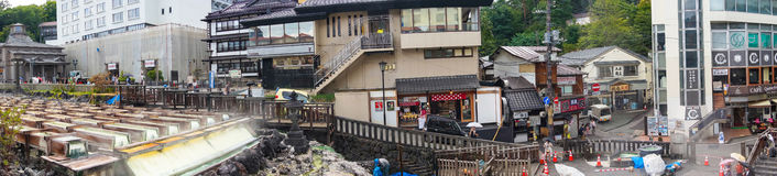 Panorama view of famous Yubatake hot spring, onsen and Kusatsu s. Kusatsu, Japan - September 7, 2016: Panorama view of famous Yubatake hot spring, onsen and Royalty Free Stock Images