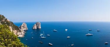 Panorama view of Faraglioni cliffs and the Tyrrhenian sea. On Capri island, Italy, Europe stock photos