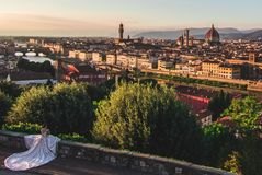 Panorama view on the Florence old town Cathedral Duomo santa maria del fiore river Arno wedding bride white dress looking royalty free stock photography
