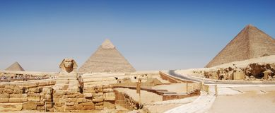 Panorama view of Giza in Cairo, the great pyramyd of Cheops, the pyramids of Kefren and Micerinos, the Sphinx royalty free stock photography