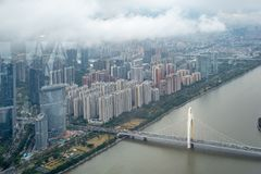 Panorama view of Guanzhou midtown with bridge over river and clouds sky royalty free stock photo