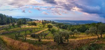 Panorama view on Fonterutoli on sunrise. It is hamlet of Castellina in Chianti in province of Siena. Tuscany. Italy. Panorama view on hamlet Fonterutoli on royalty free stock images