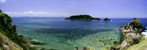 Panorama view from hill top at Kapas Island, Terengganu, Malaysia surrounded by crystal clear water, coral, island  and blue sky Royalty Free Stock Photo