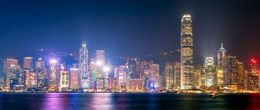 Panorama view of Hong kong downtown view from Kowloon. Panorama view of Hong kong downtown the famous cityscape view of Hong Kong skyline during twilight time Stock Images