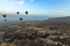 Panorama view of hot air balloons flying over Cappadocia royalty free stock images