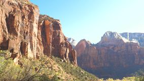 Panorama A View Of Huge Red Rocks Of The Zion Park In Sunshine And In Shade. Panorama view of huge red rocks of the Zion Park bathed in sunshine and also in stock footage