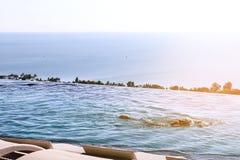 Panorama view of infinity edge swimming pool. Stock Image