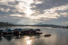 Panorama view of the lake and morning sunlight with Fisherman`s house and cloudy sky royalty free stock image