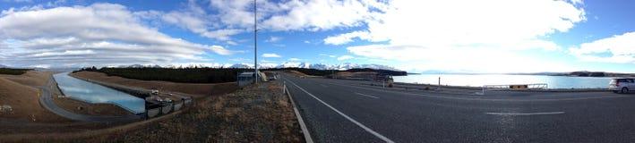 Panorama view of Lake Pukaki. Beautiful day in Lake Pukaki-panorama view across the road Stock Photos