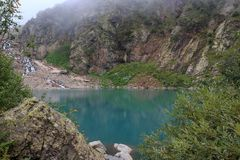Panorama view of lake scene in mountains, national park of Dombay, Caucasus. Russia. Summer landscape, sunshine weather, dramatic blue sky and sunny day stock photo