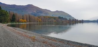 Panorama view landscape view at Wanaka lake New zealand in autumn royalty free stock photo