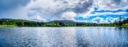 Little Heffley Lake in the Shuswap region of British Columbia,. Panorama view of Little Heffley Lake, a small fishing lake at the Heffley-Sun Peaks Road in the royalty free stock images