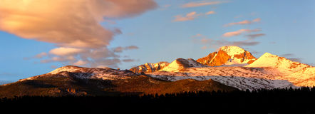 Panorama View of Longs Peak at sunrise. With pink clouds forming over the summit Stock Photo
