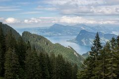 Panorama view of Lucerne lake and mountains scene in Pilatus of Lucerne. Switzerland, Europe. Summer landscape, sunshine weather, dramatic blue sky and sunny royalty free stock image
