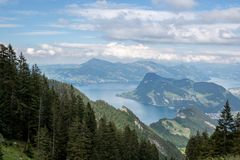 Panorama view of Lucerne lake and mountains scene in Pilatus of Lucerne. Switzerland, Europe. Summer landscape, sunshine weather, dramatic blue sky and sunny royalty free stock photos