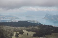 Panorama view of Lucerne lake and mountains scene in Pilatus of Lucerne. Switzerland, Europe. Summer landscape, sunshine weather, dramatic blue sky and sunny stock photos